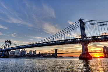 Sun Setting Behind Manhattan And Brooklyn Bridges, New York City, New York, United States Of America