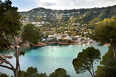 Turquoise Water In A Lake With Houses On A Hillside, Gerone, Catalonia, Costa Brava, Spain
