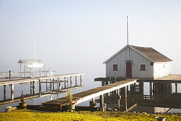 Boathouse And Sailboat On Foggy Lake, Bellingham, Washington, United States Of America