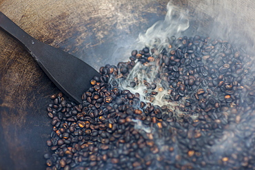 Coffee Beans Being Roasted By Hand In A Wok By The Coffee Pickers, Sumatra, Indonesia