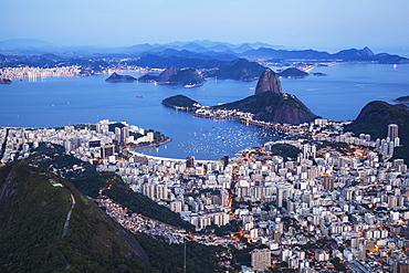 Dusk Falls On Rio De Janeiro As Viewed From Corcovado, Rio De Janeiro, Brazil