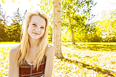 Outdoor Portrait Of A Beautiful Young Woman With Long, Blond Hair In A City Park In Autumn, Edmonton, Alberta, Canada