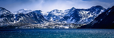 Snowy Mountains In Sunshine Beside Blue Sea, Antarctica