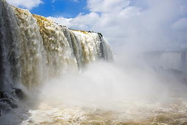 Cloud Of Spray Beneath Sunny Iguazu Falls, Parana, Brazil