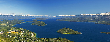 Panoramic View Of A Large Lake In Patagonia, With Snow-Capped Mountains And Blue Sky, Argentina