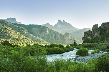 The Early Morning Sun Illuminates A Green River Valley And Sharp Mountain Peaks, Argentina