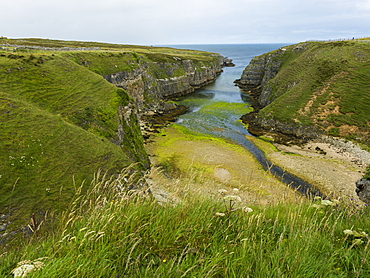A Waterway Between The Cliffs Of The Coast Leading Into A River In The Highlands, Scotland