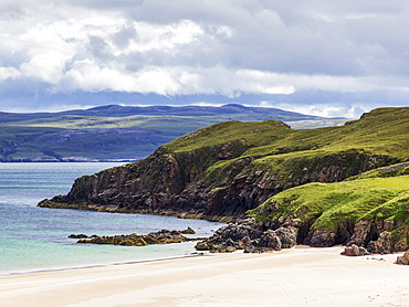 White Sand And Rugged Cliffs Along The Coastline Of The Highlands, Scotland