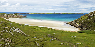 A White Sand Beach And Turquoise Water Along The Coast Of The Highlands, Scotland