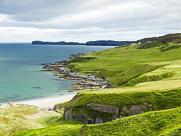 Grass Slopes Along The Rugged Coastline, Scotland