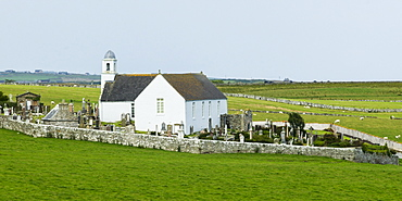 A White Church And Cemetery Surrounded By A Stone Fence, Latheron, Scotland
