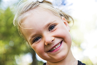 Portrait Of A Young Girl With A Big Smile And Blond Hair, Edmonton, Alberta, Canada
