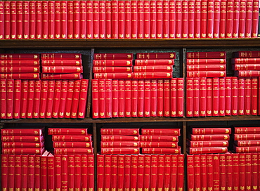Abundance Of Red Books On A Shelving Unit, Yorkshire Dales, England