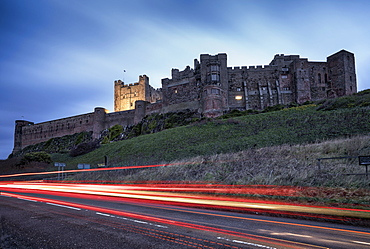 Light Trails On The Road And Bamburgh Castle, Bamburgh, Northumberland, England