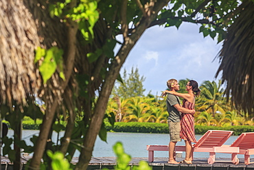 Couple On A Wooden Dock In An Embrace, Saint Georges Caye Resort, Belize City, Belize