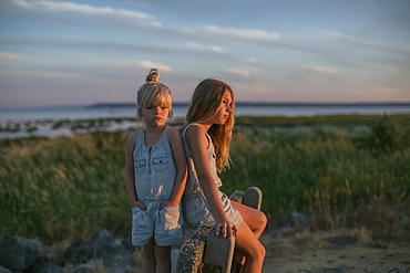 Sisters Together On The Beach At Sunset, Surrey, British Columbia, Canada