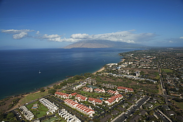 Aerial View Of Condominiums, Kihei And Wailea, A Sailboat And The West Maui Mountains, Kihei, Maui, Hawaii, United States Of America