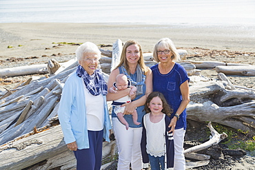 Four Generations Of Women In A Family Posing On A Beach, Fox Spit, Whidbey Island, Washington, United States Of America