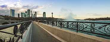 A Walkway With A City Skyline In The Background, Niagara Falls, Ontario, Canada