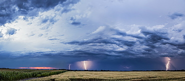 Storm Clouds And Lightning Strikes Over A Rural Landscape, Thunder Bay, Ontario, Canada