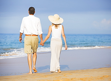Happy Senior Couple On The Beach. Retirement Luxury Tropical Resort