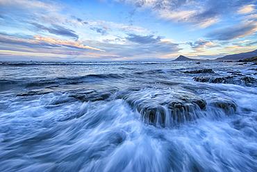 The Surf Of The Atlantic Ocean Crash Over Rocks, West Fjords, Iceland