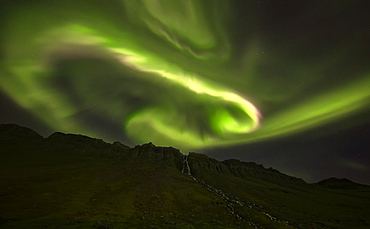 Aurora Overtop Of An Unnamed Waterfall Near The Town Of Djupavik, West Fjords, Iceland