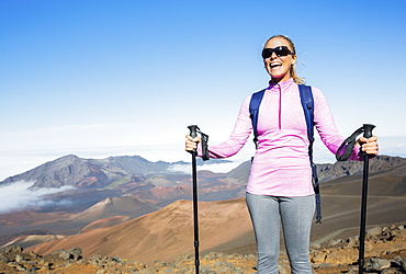 Woman Hiking On Beautiful Mountain Trail. Trekking And Backpacking In The Mountains. Healthy Lifestyle Outdoor Adventure Concept.