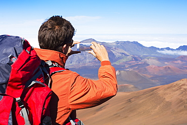 Man Taking A Photo Of The Mountains With Smartphone