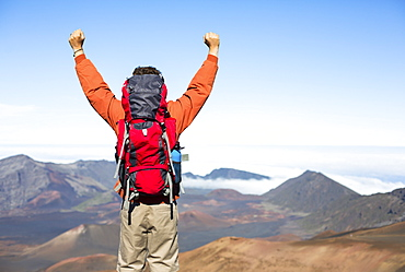 Hiker With Backpack Enjoying View From Top Of A Mountain. Celebrating Victory Making It To The Summit. Success And Achievement Concept.