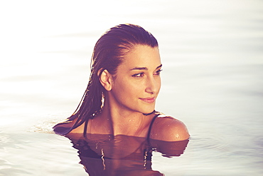 Beautiful Young Woman Relaxing In Pool At Sunset, Luxury Resort Fashion Lifestyle