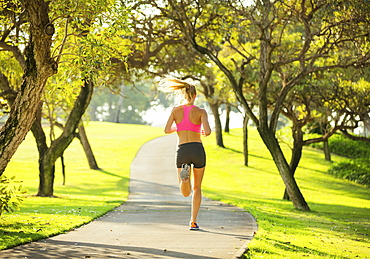 Athletic Fit Young Woman Jogging Running Outdoors Early Morning In Park. Healthy Lifestyle Sports Fitness Concept.