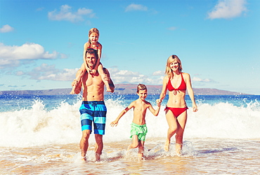 Happy Family Having Fun On Beautiful Warm Sunny Beach.