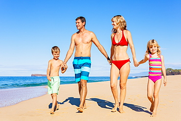 Family Vacation. Happy Family Having Fun On Beautiful Warm Sunny Beach. Outdoor Summer Lifestyle.