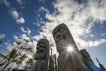Afternoon Sun Shines Through Statues At Puuhonua O Honaunau National Historic Park, Island Of Hawaii, Hawaii, United States Of America