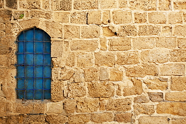Window With Blue Glass On A Stone Wall, Joppa, Israel