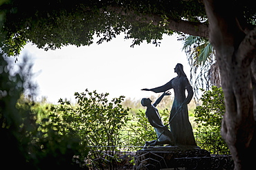 On The Sea Of Galilee, A Statue Beside The Church Of St Peter's Primacy Depicts Jesus After His Death And Resurrection, Appearing Before St. Peter, Galilee, Israel
