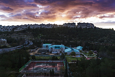 Modern Buildings And Tennis Courts Under Glowing Clouds At Sunset, Israel