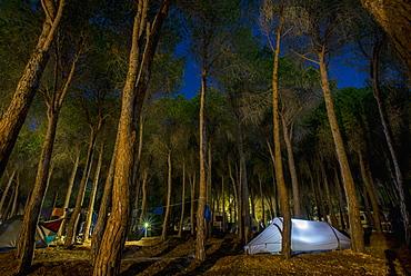 A Tent Illuminated At Dusk At A Campground, Cala Gonone, Sardinia, Italy