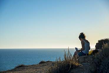 Girl Painting At The Water's Edge, Tharros, Sardinia, Italy