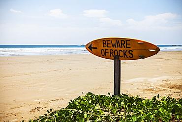 A Warning Sign On A Surfboard In Playa Hermosa, Nicaragua