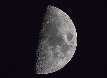 Half Of The Moon Illuminated In A Dark Sky