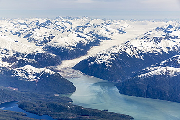 Aerial View Of A Tidewater Glacier In The Inside Passage, And Snow Capped Peaks, Wrangell, Southeast Alaska, USA, Spring