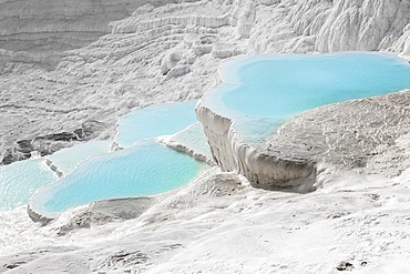 Hot Springs And Travertines, Terraces Of Carbonate Minerals Left By The Flowing Water, Pamukkale, Turkey