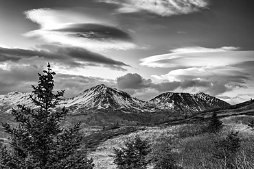 Black And White Photo Of Lenticular Clouds Over The Three Sisters Mountains, Kodiak Island, Southwest Alaska