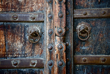 Close Up Of Old Wooden Door With Brass Rings, Dharpatha Mal, Madhya Pradesh, India