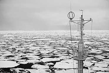 Mast Of A Ship In The Sea Filled With Floating Ice, Spitsbergen, Svalbard, Norway