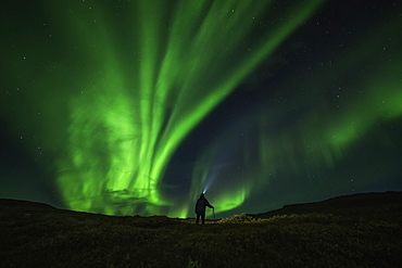 Man Standing Under The Northern Lights, Near Keno, Yukon, Canada