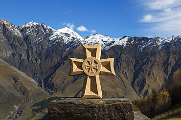 Stone Fountain With A Cross With The Caucasus Mountains In The Background, Kazbegi, Mtskheta-Mtianeti, Georgia