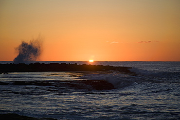 Sunset Over The Ocean With Splashing Waves, Oahu, Hawaii, United States Of America